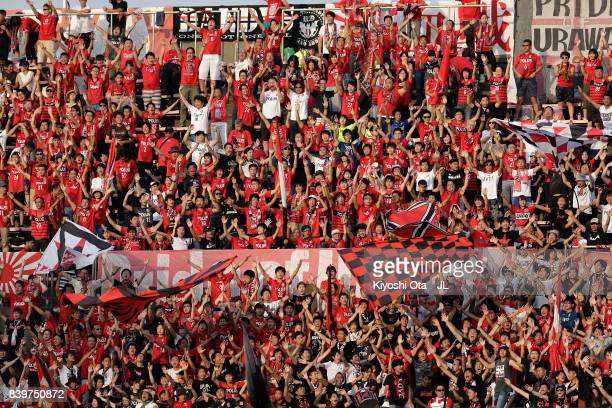 Urawa Red Diamonds supporters cheer prior to the JLeague J1 match between Shimizu SPulse and Urawa Red Diamonds at IAI Stadium Nihondaira on August...