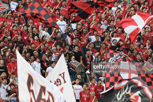 Urawa Red Diamonds supporters cheer prior to the JLeague J1 match between Urawa Red Diamonds and Sagan Tosu at Saitama Stadium on September 23 2017...