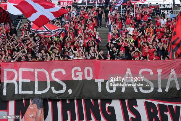 Urawa Red Diamonds supporters cheer prior to the JLeague J1 match between Sanfrecce Hiroshima and Urawa Red Diamonds at Edion Stadium Hiroshima on...
