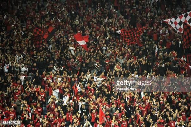 Urawa Red Diamonds supporters cheer prior to the JLeague J1 match between Urawa Red Diamonds and Kawasaki Frontale at Saitama Stadium on November 29...