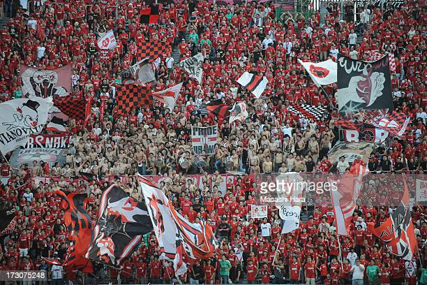 Urawa Red Diamonds supporters cheer prior to the JLeague match between Ventforet Kofu and Urawa Red Diamonds at the National Stadium on July 6 2013...