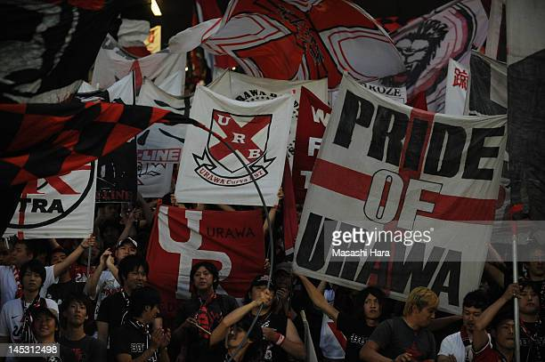 Urawa Red Diamonds supporters hold bunners and flags prior to the JLeague match between FC Tokyo and Urawa Red Diamonds at Ajinomoto Stadium on May...