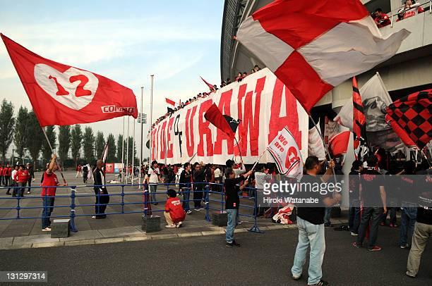 Urawa Red Diamonds supporters wave flags prior to the JLeague match between Urawa Red Diamonds and Jubilo Iwata at Saitama Stadium on November 3 2011...