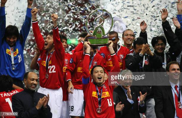 Urawa Reds captain Keita Suzuki holds the championship trophy to celebrate their championship with teammates against Iran's Sepahan after the game of...