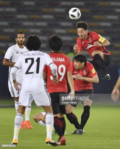 Urawa Reds' captain Yuki Abe leaps for a header in the first half of a 10 loss to Al Jazira in a Club World Cup second round match at Zayed Sports...