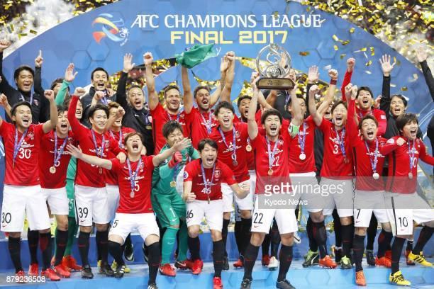 Urawa Reds captain Yuki Abe lifts the Asian Champions League trophy after his team won the title at Saitama Stadium on Nov 25 2017 ==Kyodo