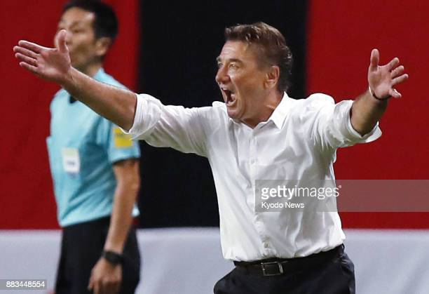 Urawa Reds coach Mihailo Petrovic gives instructions to his players during a JLeague match against Consadole Sapporo at Sapporo Dome on July 29 2017...