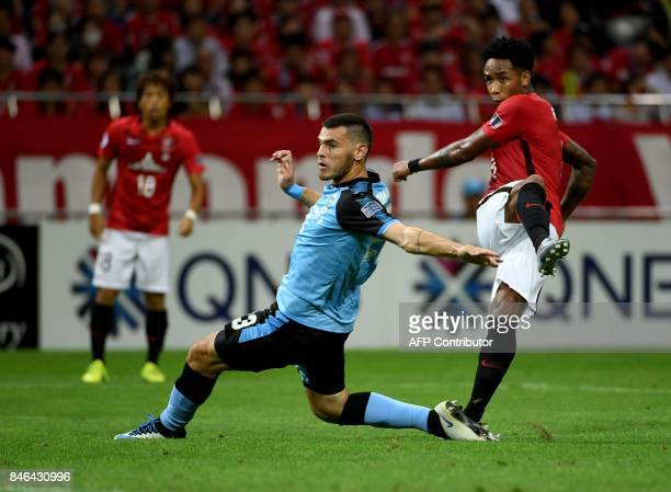 Urawa Reds forward Rafael Da Silva shoots to score a goal beside Kawasaki Frontale defender Eduardo during the AFC Champions League quarter final...