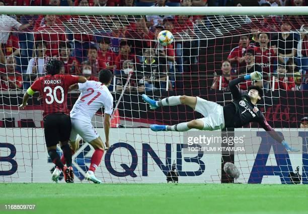 TOPSHOT Urawa Reds forward Shinzo Koroki shoots to score a goal during the AFC Champions League football quarterfinals second leg match between Urawa...
