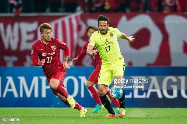 Urawa Reds Forward Zlatan Ljubijankic fights for the ball with Shanghai FC Defender Shi Ke during the AFC Champions League 2017 Group F match between...