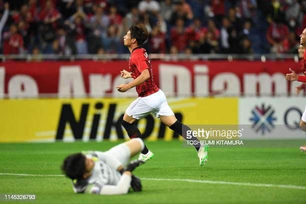 Urawa Reds' Kazuki Nagasawa celebrates after scoring a goal during the AFC Champions League group G football match between Japan's Urawa Reds and...
