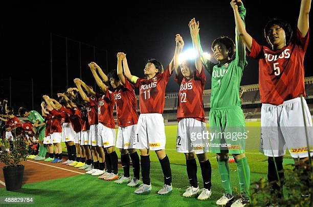 Urawa Reds Ladies players celebrate their team's 1-0 win after the Nadeshiko League match between Urawa Red Diamonds Ladies and Okayama Yunogo Belle...