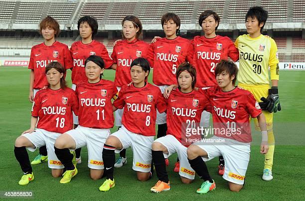 Urawa Reds Ladies players line up for the team photos prior to the Nadeshiko League match between Urawa Red Diamonds Ladies and INAC Kobe Leonessa at...