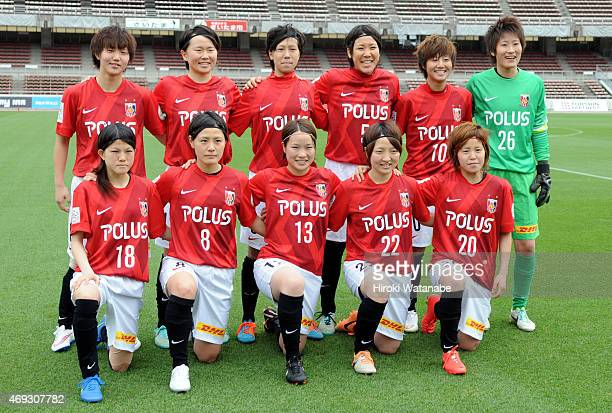 Urawa Reds Ladies players line up for the team photos prior to the Nadeshiko League match between Urawa Red Diamonds Ladies and AS Elfen Saitama at...