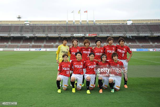 Urawa Reds Ladies players pose for photograph prior to the Nadeshiko League 2014 match between Urawa Reds Ladies and Albirex Niigata Ladies at Urawa...