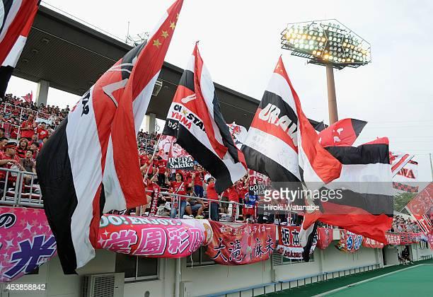 Urawa Reds Ladies supporters cheer during the Nadeshiko League match between Urawa Red Diamonds Ladies and INAC Kobe Leonessa at Komaba Stadium on...