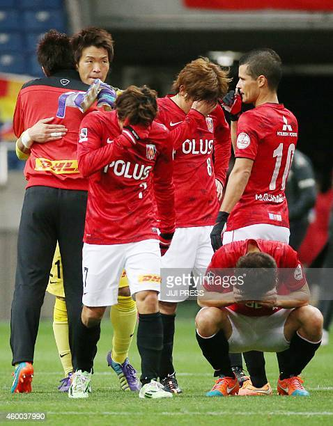 Urawa Reds players react after losing a match against Nagoya Grampus in Saitama on December 6 2014 Gamba Osaka captured their second JLeague...