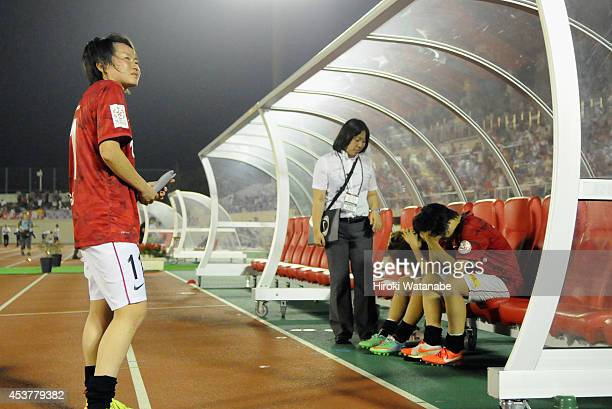 Urawa Reds players reacts after the 01 defeat in the Nadeshiko League match between Urawa Red Diamonds Ladies and INAC Kobe Leonessa at Komaba...