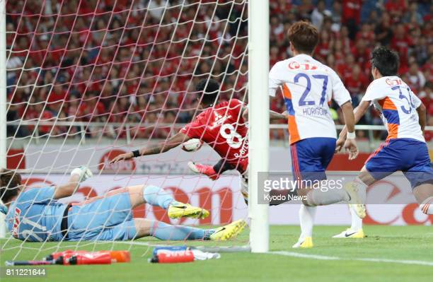 Urawa Reds striker Rafael Silva scores during the second half of a game against Albirex Niigata in Saitama on July 9 2017 The Reds came from behind...