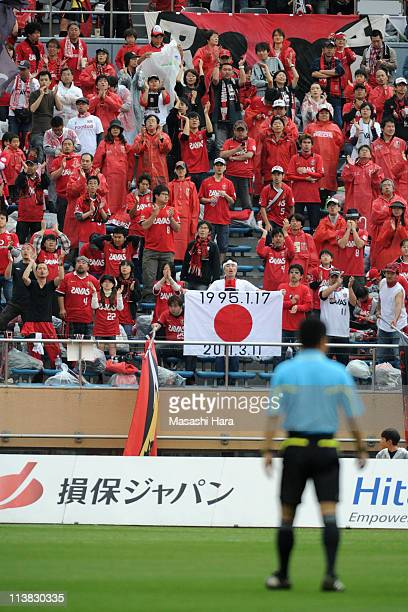 Urawa Reds supporter hold up Japanese Nathional flag with message1995 South Hyogo Prefecture Earthquake and 2011 off the Pacific coast of Tohoku...
