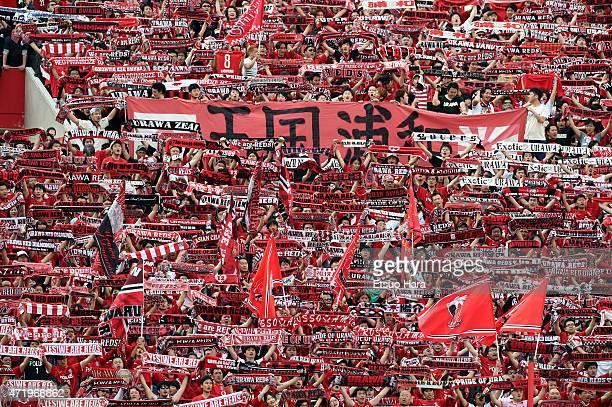 Urawa Reds supporters cheer during the JLeague match between Urawa Red Diamonds and Gamba Osaka at Saitama Stadium on May 2 2015 in Saitama Japan