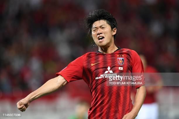Urawa Reds' Yuki Muto celebrates after scoring a goal during the AFC Champions League group G football match between Japan's Urawa Reds and China's...