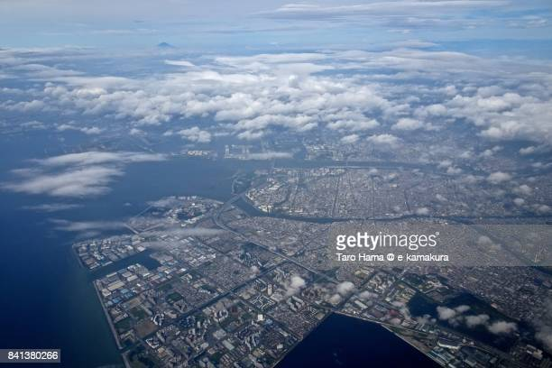 Urayasu city in Chiba prefecture, Edogawa district in Tokyo, Tokyo Bay and Mt. Fuji day time aerial view from airplane