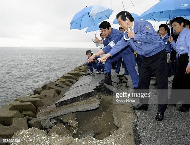 Urayasu Japan Japanese Prime Minister Naoto Kan views damage to revetments along the shore of Tokyo Bay in Urayasu Chiba Prefecture on June 18 2011...