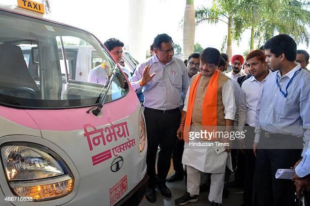 Urban administration minister Kailash Vijayvargiya having a look at Nirbhaya Taxi on March 18 2015 in Indore India Madhya Pradesh government is...