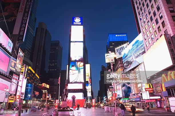 Urban advertisements lit up at night