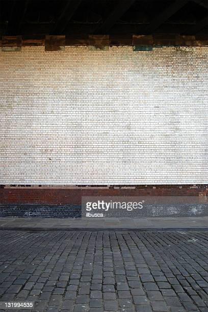 Urban background UK - White brick wall with sidewalk