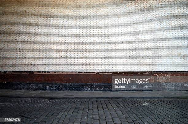 urban background uk - white brick wall with sidewalk - street stock pictures, royalty-free photos & images