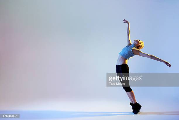urban ballet dancer in elegant pose - dancing stock pictures, royalty-free photos & images