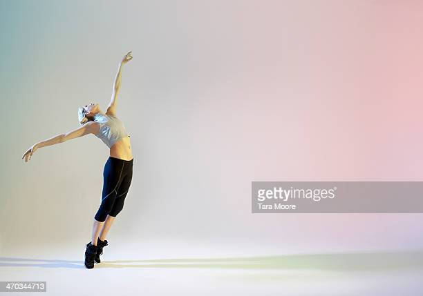 urban ballet dancer in graceful pose - dancing stock pictures, royalty-free photos & images