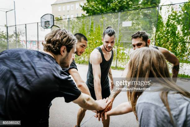 Urban Basketball Players Holding Hands, Getting Motivated
