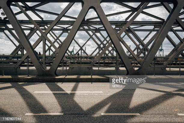 urban bridge and road, steal bridge in hamburg - hamburg germany stock pictures, royalty-free photos & images