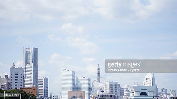 urban buildings against the sky - yokohama stock pictures, royalty-free photos & images