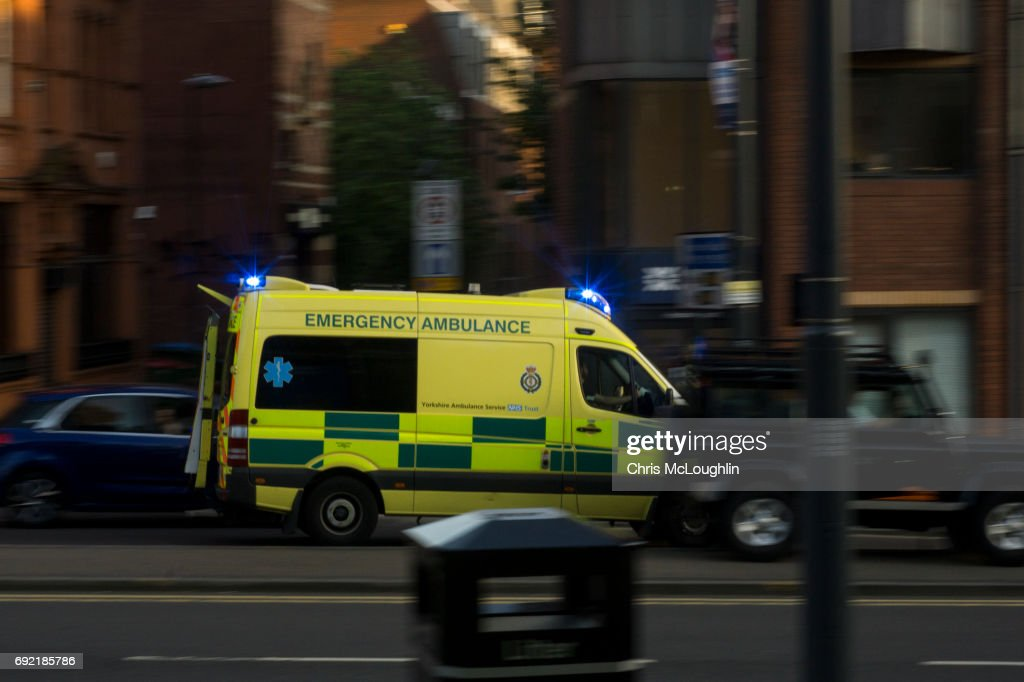 Urban city scene in Leeds, UK, Ambulance : Stock Photo