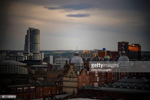 urban city scene in leeds, uk. cobble street - leeds skyline stock photos and pictures