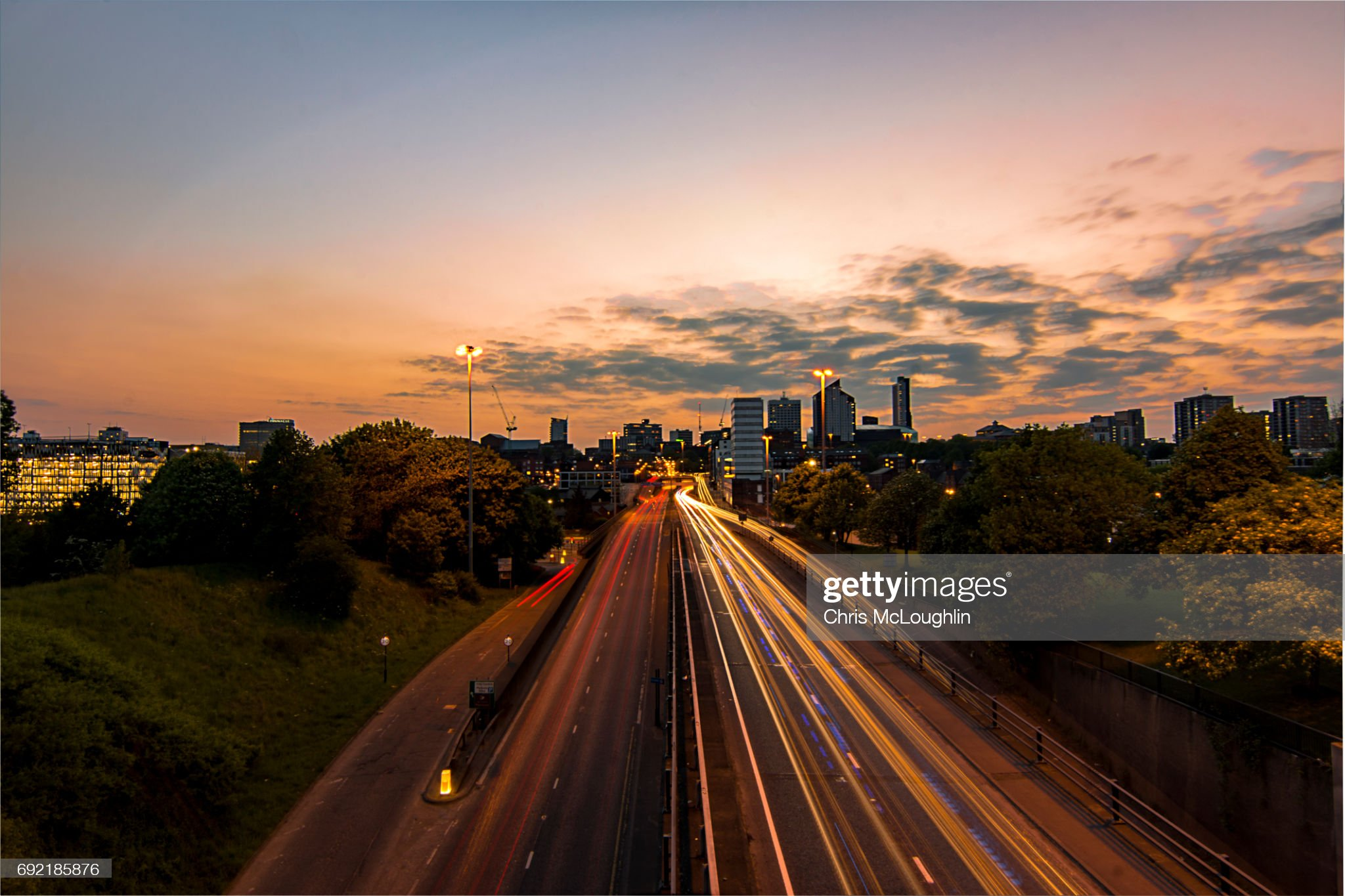 Urban city scene in Leeds, UK. Road into Leeds : Stock Photo