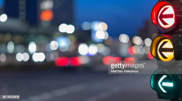 urban city street szene with colorful traffic lights and bokeh night lights - road signal stock pictures, royalty-free photos & images