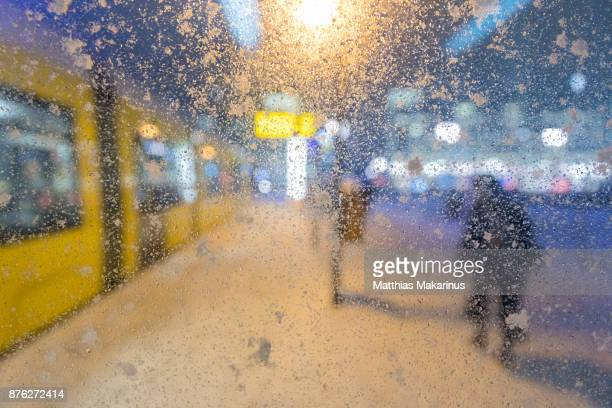Urban City Street Winter Szene with Bokeh Night Lights defocused Train and Snow