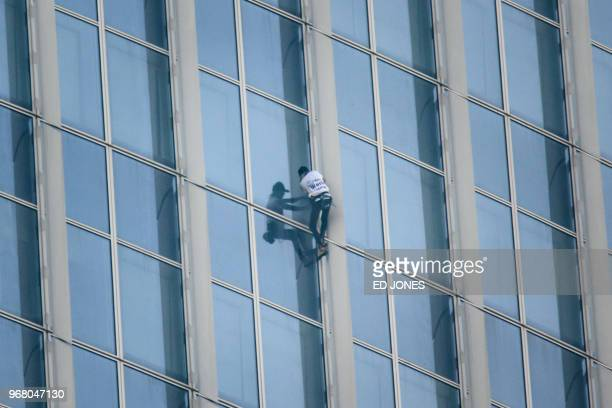'Urban climber' Alain Robert of France scales the exterior of the Lotte World Tower in Seoul on June 6 2018 French 'Spiderman' Alain Robert who holds...