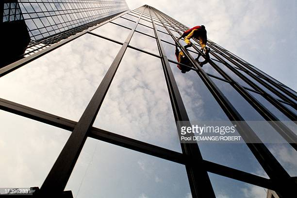 Urban Climber Alain Robert Scaling the Deutsch Bank Building In Frankfurt Germany In May 1998 French rock and urban climber Alain Robert Known as...