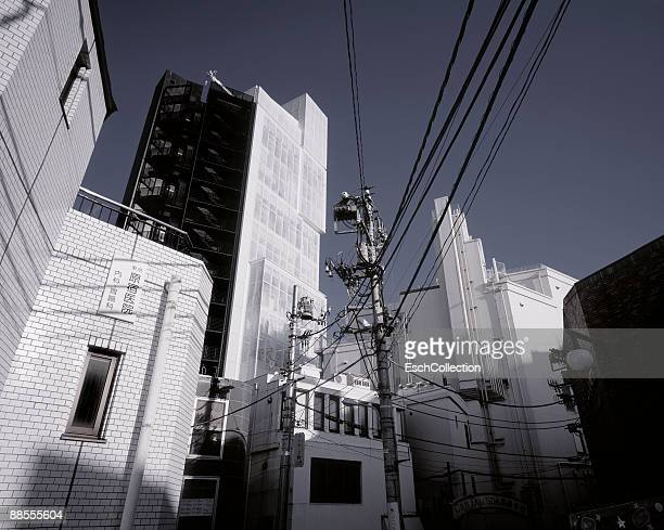 Urban composition with buildings and cables.