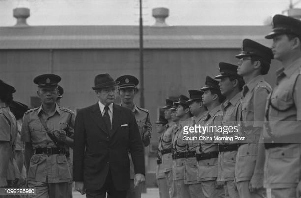 Urban Councillor John MacKenzie inspecting a passingout parade of officers of the Royal Hong Kong Auxiliary Police Force who completed an annual...