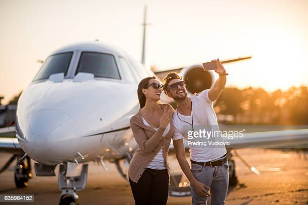 Urban couple making a selfie at the airport