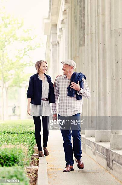 urban couple outdoors - tall person stock pictures, royalty-free photos & images