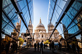 Urban crowd and futuristic architecture in the city, London, UK
