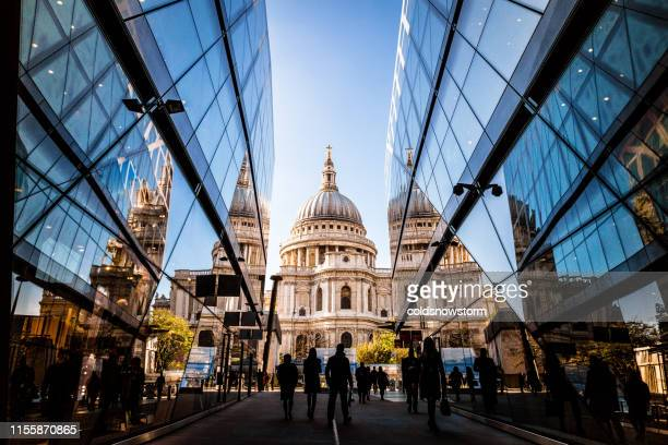 urban crowd and futuristic architecture in the city, london, uk - london england stock pictures, royalty-free photos & images